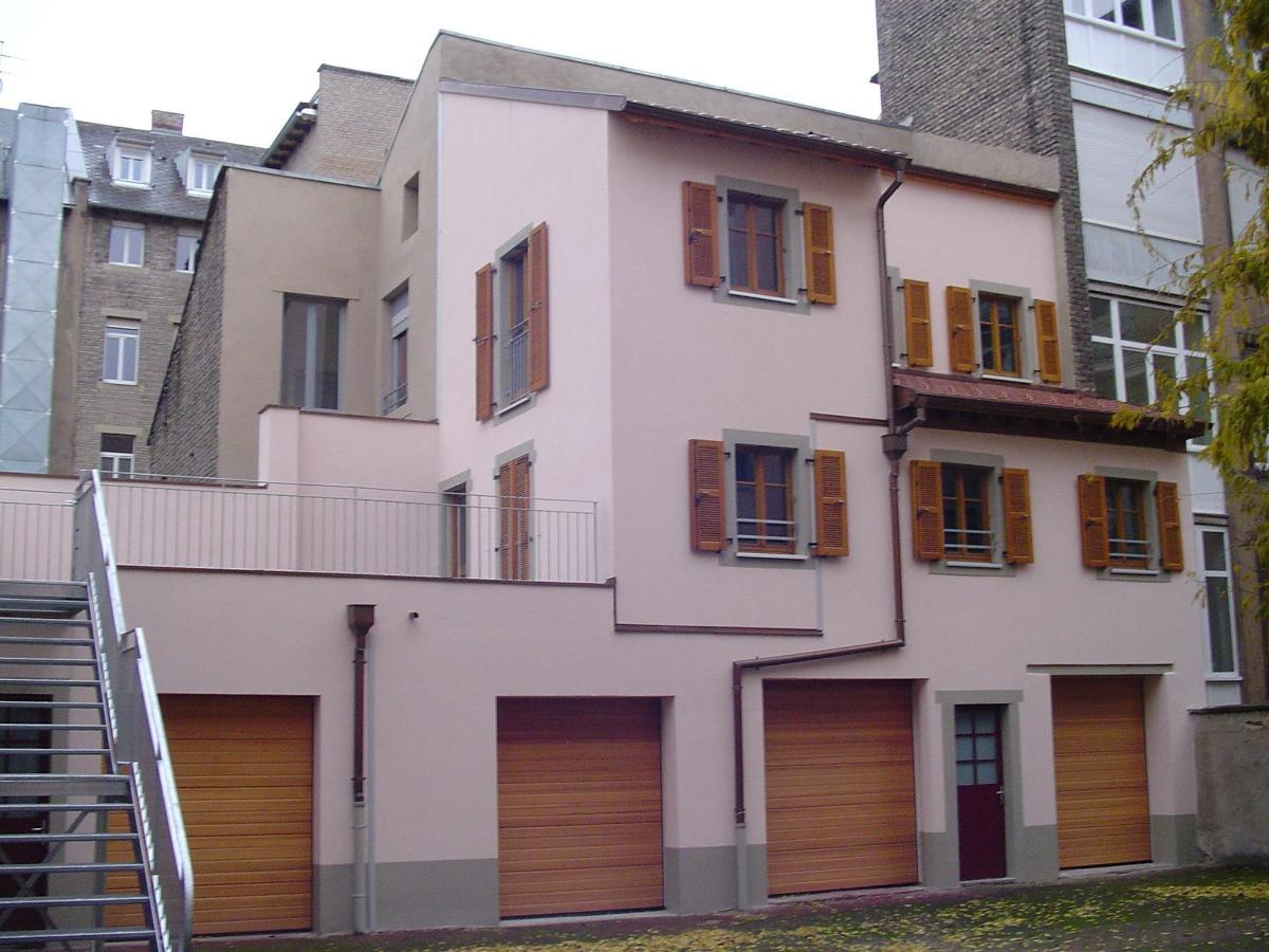 Construction : 2 appartements sur garages existants, ossature bois