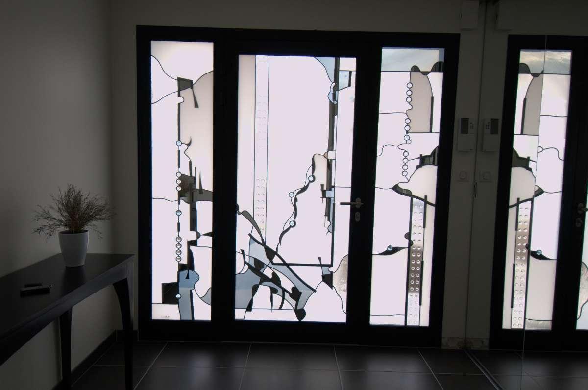 Porte d'entrée, Remplissage par panneau avec mise en plomb -
